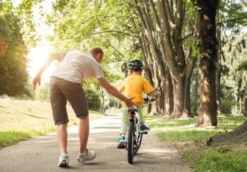 teaching a kid to ride a bike